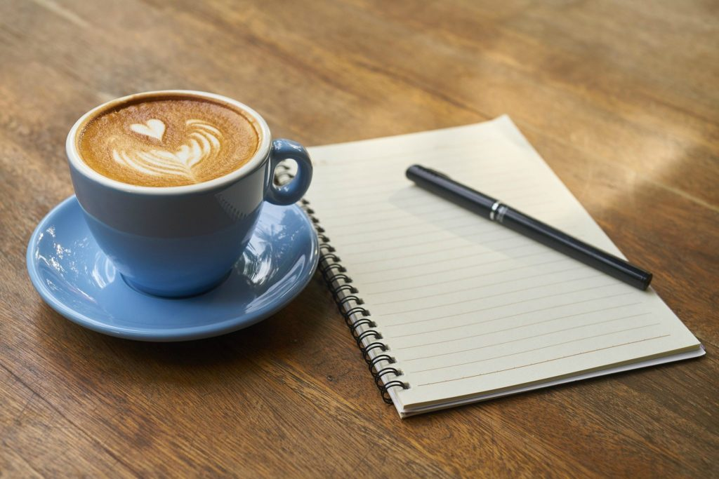 coffee, pen and notebook